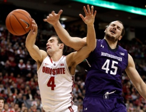 Ohio State's Aaron Craft and  Northwestern's Nikola Cerina reach for a rebound. (AP Photo/Paul Vernon)