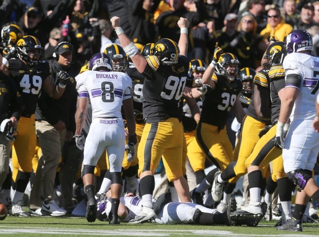 Last year's game in Iowa City ended with Kain Colter on the ground in overtime. Can the 'Cats get revenge Saturday, and snap a three-game losing streak in the process? Photo credit: Byron Houlgrave, Des Moines Register.
