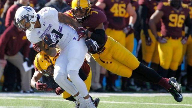 Kyle Prater caught this pass in front of Minnesota's Damarius Travis, but Prater had a key drop on fourth down and Travis intercepted a late Hail Mary as the Gophers beat Northwestern. Photo credit: Ann Heisenfelt, AP