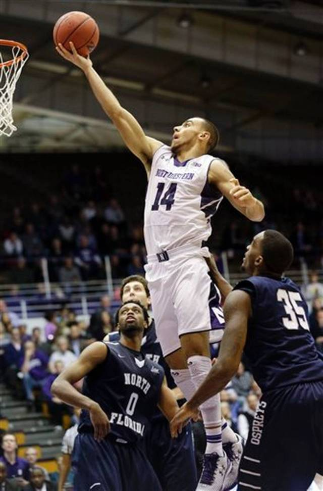 After a rough first couple games, Tre Demps came through late Thursday as the 'Cats rallied past North Florida. Was it enough to earn him player of the game honors from our staff? Photo credit: Nam Y. Huh, AP.