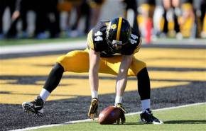 Iowa's Ben Niemann falls on a punt in the end zone Saturday against Northwestern with no Wildcats in sight. Everything was pretty much this easy for the Hawkeyes, who rolled past Northwestern. Photo credit: Justin Hayworth, AP.