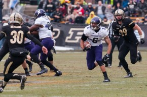After struggling with drops and muffs the past couple of weeks, Tony Jones dropped Purdue defenders with a spin move and returned a punt for a touchdown Saturday. Photo credit: Nathan Richards, the Daily Northwestern.