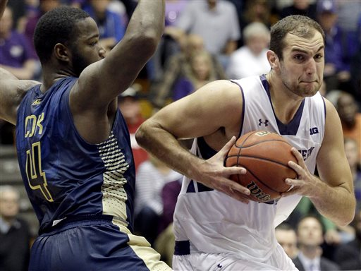 After a rough second-half, Alex Olah and his game face brought the Wildcats close, but they couldn't overtake Georgia Tech. Photo credit: Nam Y. Huh, AP.