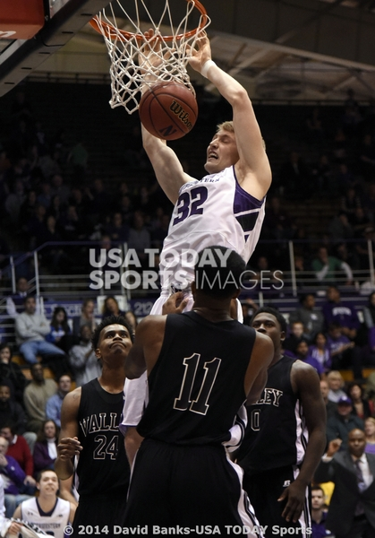 Nathan Taphorn went air-borne for a power slam in NU's big win over MVSU, part of Northwestern's 3-1 start to a 5-game holiday homestand. Photo credit: David Banks, USA Today Sports.