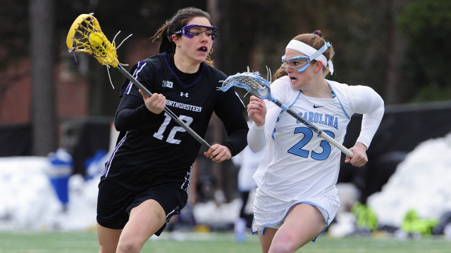 Northwestern's Kaleigh Craig carries the ball against North Carolina. Craig scored twice in the 'Cats' 12-11 loss to the second-ranked Tar Heels. Photo credit: Jeffrey A. Camarati