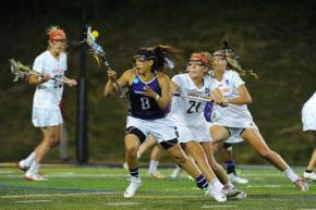 Northwestern Kara Mupo and Maryland's Taylor Cummings battled at last year's Final Four, and they'll go at it again tonight. Cummings ranks among the NCAA leaders in draw controls, while Mupo is coming off a five-goal game against Syracuse. Photo credit: Greg Wall.
