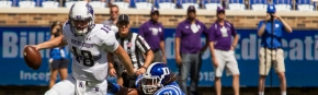 September 19, 2015: Northwestern Wildcats quarterback Clayton Thorson (18) avoids tackle from Duke Blue Devils defensive end Marquies Price (91) during the NCAA College Football game between the Northwestern Wildcats and the Duke Blue Devils in Durham, N.C.  Northwestern won 19-10.