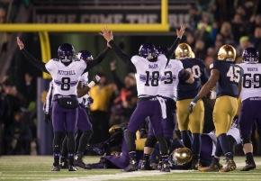 Nov 15, 2014; South Bend, IN, USA; Northwestern Wildcats kicker Jack Mitchell (8) and holder Christian Salem (18) react after a field goal in the fourth quarter against the Notre Dame Fighting Irish at Notre Dame Stadium. Northwestern won 43-30 in overtime. Mandatory Credit: Matt Cashore-USA TODAY Sports ORG XMIT: USATSI-182644 ORIG FILE ID:  20141115_lbm_sc5_186.JPG