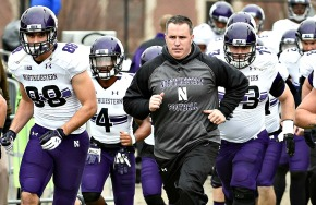 Nov 22, 2014; West Lafayette, IN, USA; Northwestern Wildcats head coach Pat Fitzgerald leads his team onto the field before the game against the Purdue Boilermakers at Ross Ade Stadium. Mandatory Credit: Sandra Dukes-USA TODAY Sports