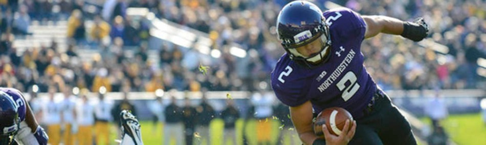 Oct 27, 2012; Evanston, IL, USA; Northwestern Wildcats quarterback Kain Colter (2) rushes for a touchdown against Iowa Hawkeyes linebacker Christian Kirksey (20) at Ryan Field. Mandatory Credit: Mike DiNovo-US PRESSWIRE ORG XMIT: USPW-91396